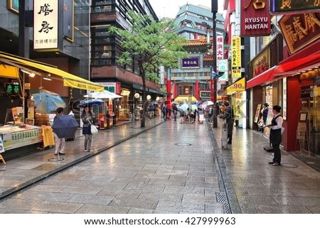 YOKOHAMA, JAPAN - MAY 10, 2012: Visitors shop in Chinatown of Yokohama, Japan. Yokohama's Chinatown is the largest in Japan and a popular tourism attraction.