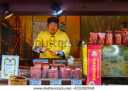 YOKOHAMA, JAPAN - NOVEMBER 24 2015: Chinese vendor on a treet of Yokohama Chinatown, Japan's largest chinatown - stock photo