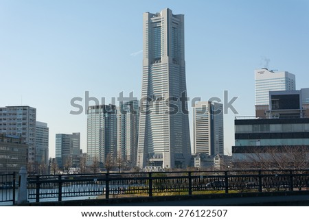 YOKOHAMA, JAPAN - NOVEMBER 9, 2014: Landmark Tower and Nippon Maru ship museum in Nippon Maru Memorial Park
