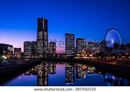 Yokohama Minato Mirai 21 seaside urban area in central Yokohama at dusk - stock photo