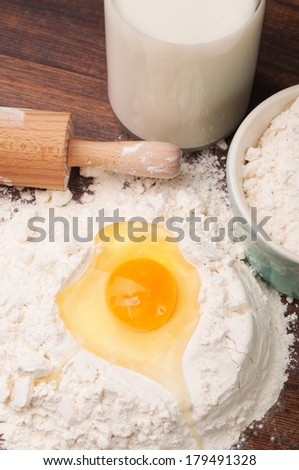 Yolk and egg white in flour on a table