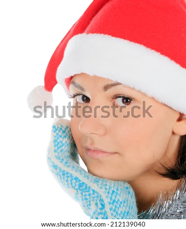 Yong female in santa hat over white - stock photo