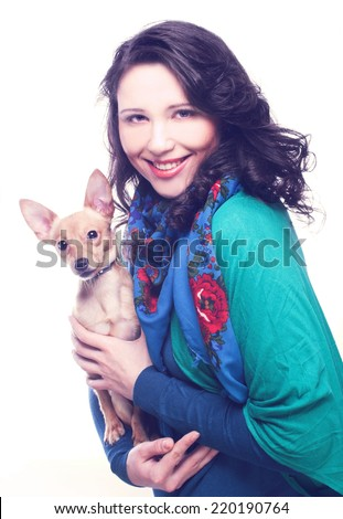 Yong happy woman posing with little dog - stock photo