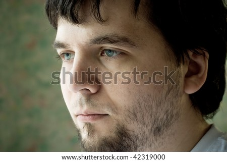 yong tired bearded man - stock photo