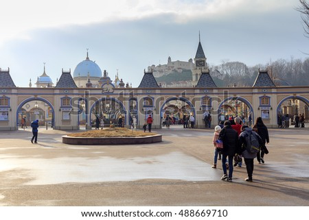 YONGIN, KOREA -DEC 15, 2012 : Tourists at the main entrance of Everland, Yongin, Gyeonggi-do province, South Korea. Everland is the largest theme park in South Korea.