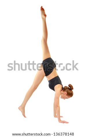 Yoong woman doing stretching excersises isolated on white background - stock photo