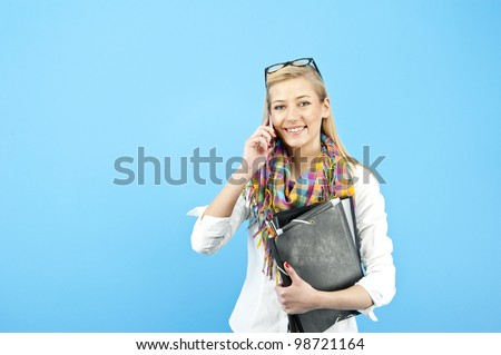 yopung woman student calling by mobile phone - stock photo