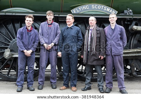 YORk, ENGLAND - FEBRUARY 25: Michael Portillo and Train Drivers of The Flying Scotsman at the NRM after its inaugural trip from Kings Cross (London) on August 25 2016 in York, England. - stock photo