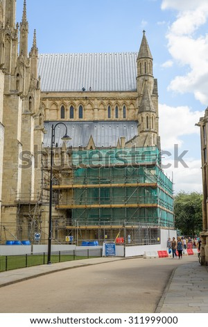 YORK, ENGLAND - JULY 16: View of York Minster in York, England, on July 16, 2015. York Minster is a cathedral in York and is one of the largest of its kind in Northern Europe. Shows building works. - stock photo