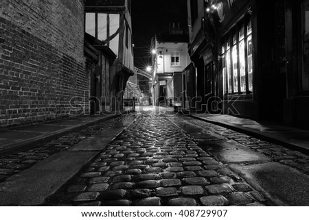 YORK, UK - April 12: Cobbled street at night on April 12, 2016 in York.