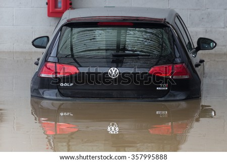YORK, UK - DECEMBER 28th 2015: Flooded streets of York City Centre and a submerged car after heavy rain, on 28th December  2015, - stock photo