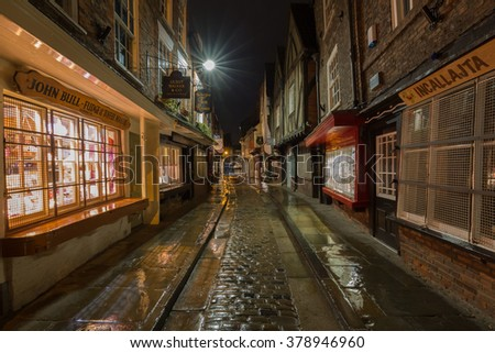 YORK, UK - February 16: The Shambles is a former butchers' street in York with some buildings dating back from the fourteenth century. February 16, 2016 in York. - stock photo