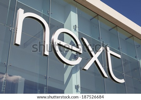 YORK, UNITED KINGDOM  APRIL 15, 2014: Entrance sign of the Next store in York, UK. Next plc is one of the largest clothing, footwear and home products retailers in the UK - stock photo