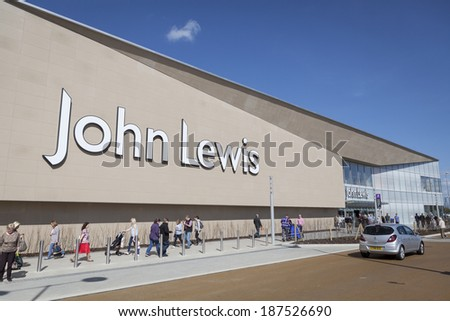YORK, UNITED KINGDOM  APRIL 15, 2014: Shoppers walking around John Lewis store in York, UK. John Lewis is a chain of department stores founded in 1864 and operating throughout the United Kingdom.  - stock photo