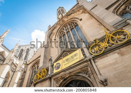 YORK, UNITED KINGDOM - JUNE 25, 2014: St Michael le Belfrey church in York with bicycle decorations before the Tour De France cycling race, which in 2014 starts in Leeds and passes through York - stock photo