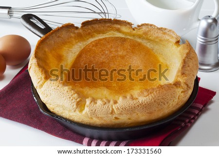 Yorkshire Pudding - a large size Yorkshire Pudding, fresh from the oven and ready for eating in the traditional Yorkshire way - as a first course with gravy. - stock photo