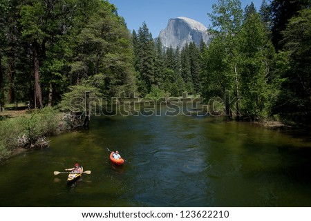 YOSEMITE NATIONAL PARK - MAY 24: View of the Merced river in Yosemite valley with a pair of kayakers on May 24th, 2009 in Yosemite National Park. - stock photo