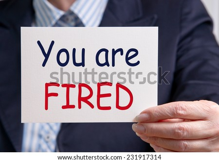 You are fired - Businesswoman with card - stock photo