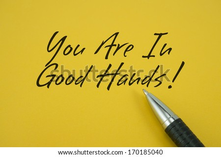 You Are In Good Hands note with pen on yellow background