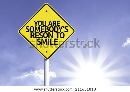You Are Somebody's Reason to Smile road sign with sun background  - stock photo