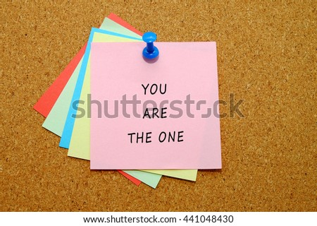 You are the one written on color sticker notes over cork board background.