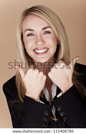 You blond businesswoman holding her thumbs up. Thumbs up.