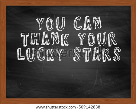 YOU CAN THANK YOUR LUCKY STARS handwritten chalk text on black chalkboard