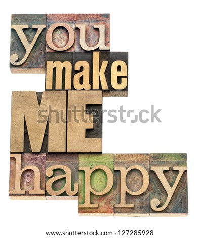 you make me happy - isolated text in vintage letterpress wood type printing blocks - stock photo