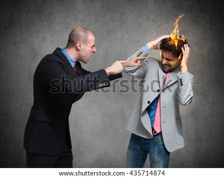 "You're fired! Conceptual image of a businessman ""firing"" another one"