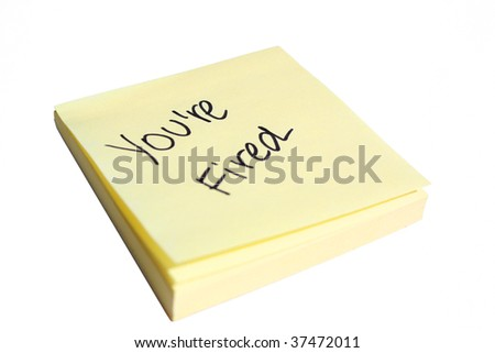 You're Fired on a post-it note - stock photo