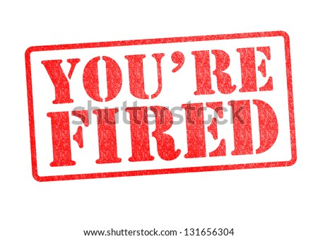 YOU'RE FIRED Rubber Stamp over a white background. - stock photo
