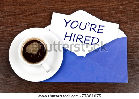 You're hired message and coffee - stock photo