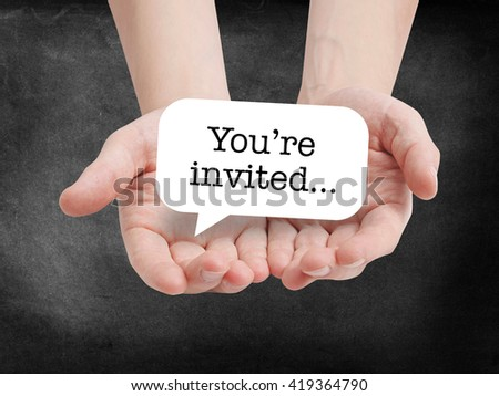 You're invited written on a speechbubble - stock photo
