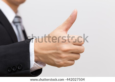You so right, Business asian man hand show Thumb up on white background