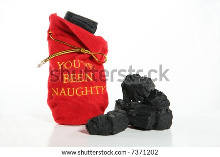 You've Been Naughty: Lumps of coal in a red embroidered sack tell what the naughty receive for Christmas. Red sack with black coal against a white background. - stock photo