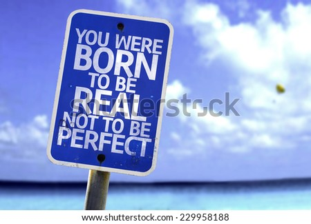 You Were Born To Be Real Not To Be Perfect sign with a beach on background - stock photo