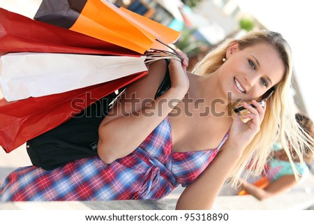 Youg busy woman shopping - stock photo
