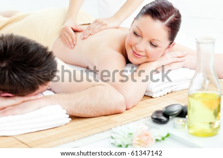 Youg couple having a talk during a back massage in a spa