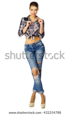 Youn girl in blue jeans isolated - stock photo