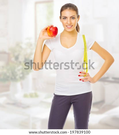 Youn girl with apple at light room - stock photo