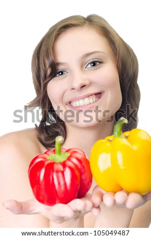 Yound pretty woman with peppers, isolated