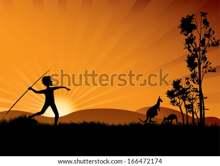 young aboriginal man hunting in the sunset - stock photo