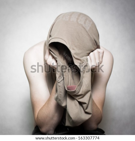 Young abused boy - stock photo