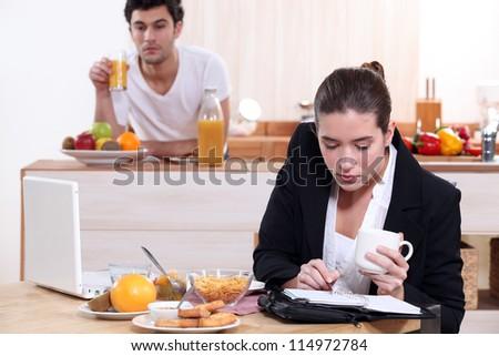 young active couple having breakfast - stock photo