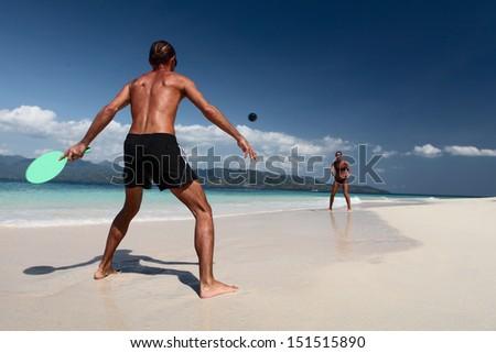 Young active couple having fun on the tropical beach - stock photo