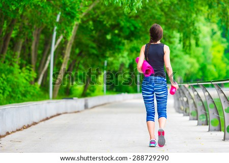 Young active fitness woman doing exercises outdoors - stock photo