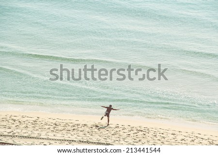 Young, Active Man in His 30's Exercising on the Beach - stock photo
