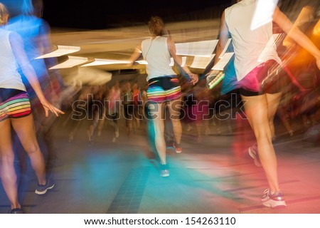 Young active people dancing in gym, fitness dance class - stock photo