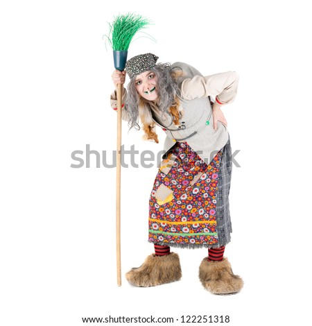 young actor in the costume of Baba Yaga - stock photo