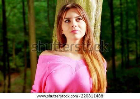 young adorable woman closeup portrait near tree - stock photo